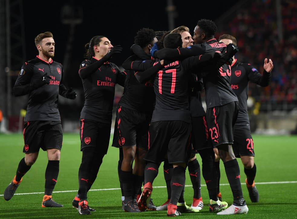 Arsenal celebrate their third goal in Sweden
