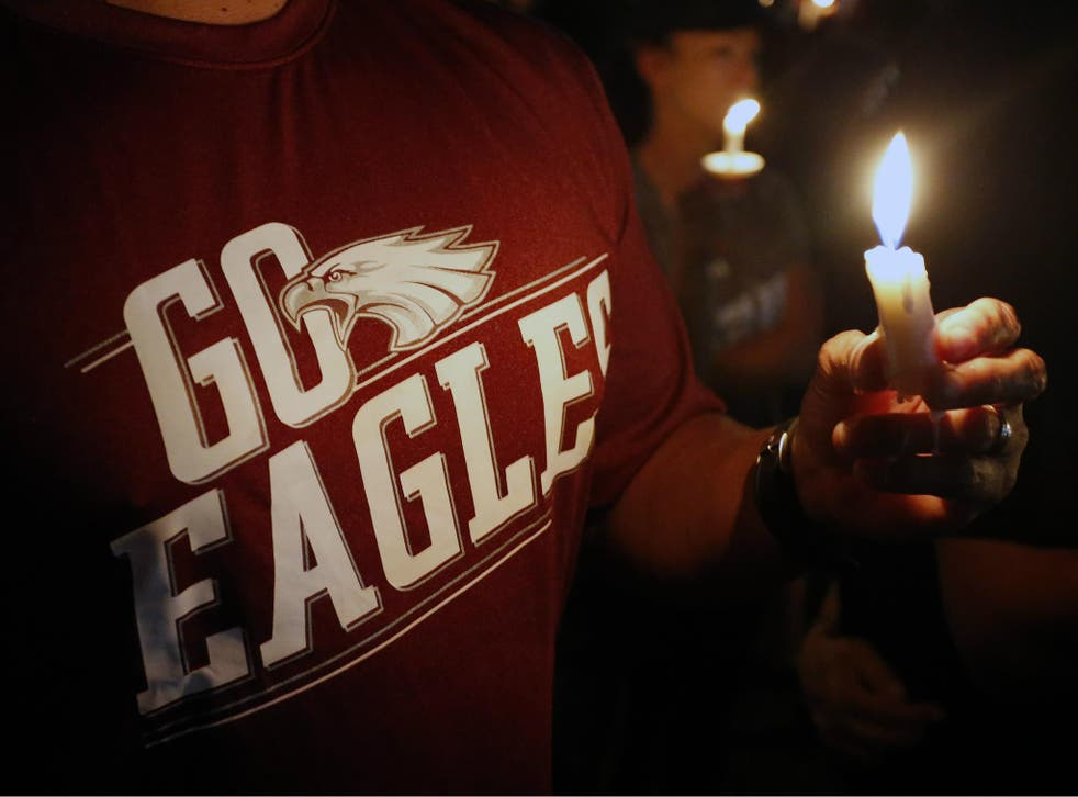 Thousands of mourners attend a candlelight vigil for victims of the Marjory Stoneman Douglas High School shooting in Parkland, Florida on 15 February 2018