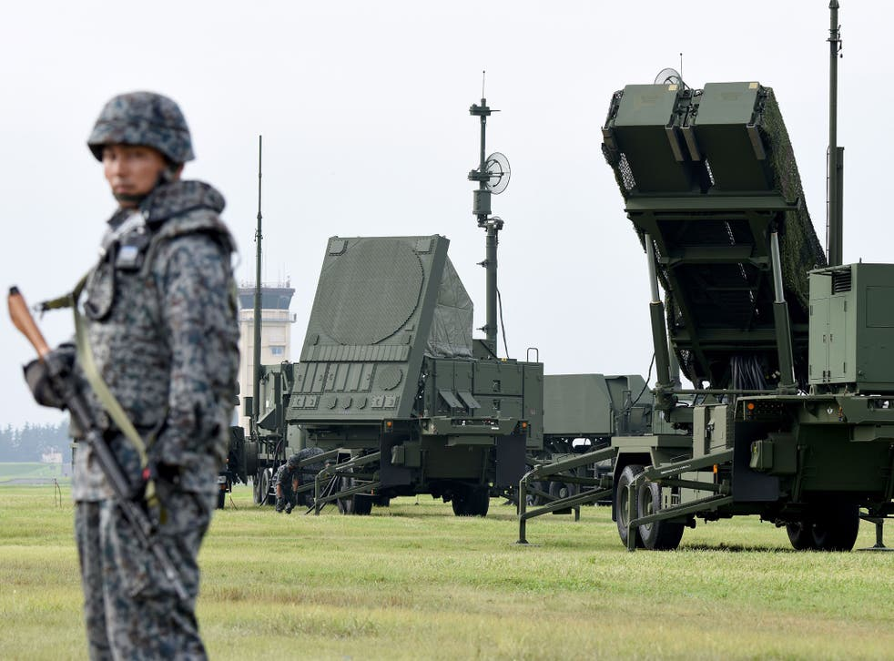 Soldiers from the Japan Air Self-Defence Force set up PAC-3 surface-to-air missile launch systems during a temporary deployment drill at US Yokota Air Bace in Tokyo
