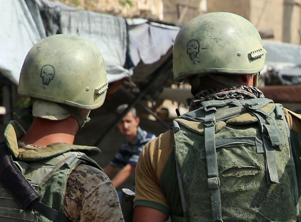 Russian soldiers on guard in Syria's eastern city of Deir Ezzor. The Kremlin says it does not track the presence of other Russian nationals in the country