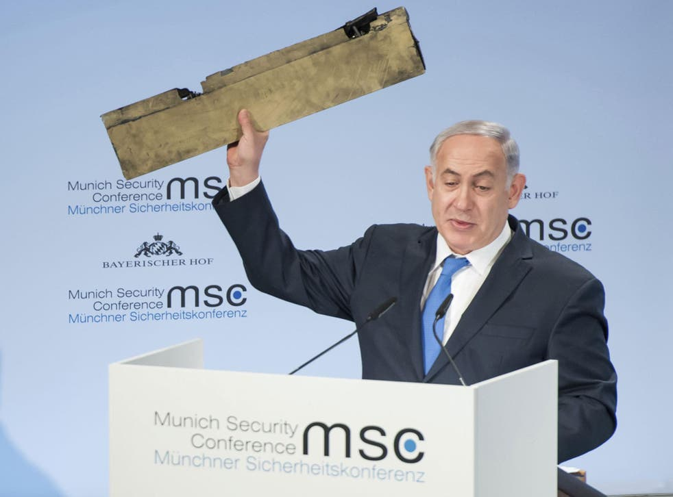 Benjamin Netanyahu, Israel's Prime Minister, holds a part of a downed drone during his speech at the Munich Security Conference