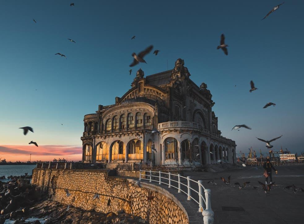 Birds circling Constanta Casino at dawn