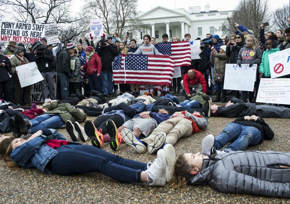 Students stage 'lie-in' at White House to protest Donald