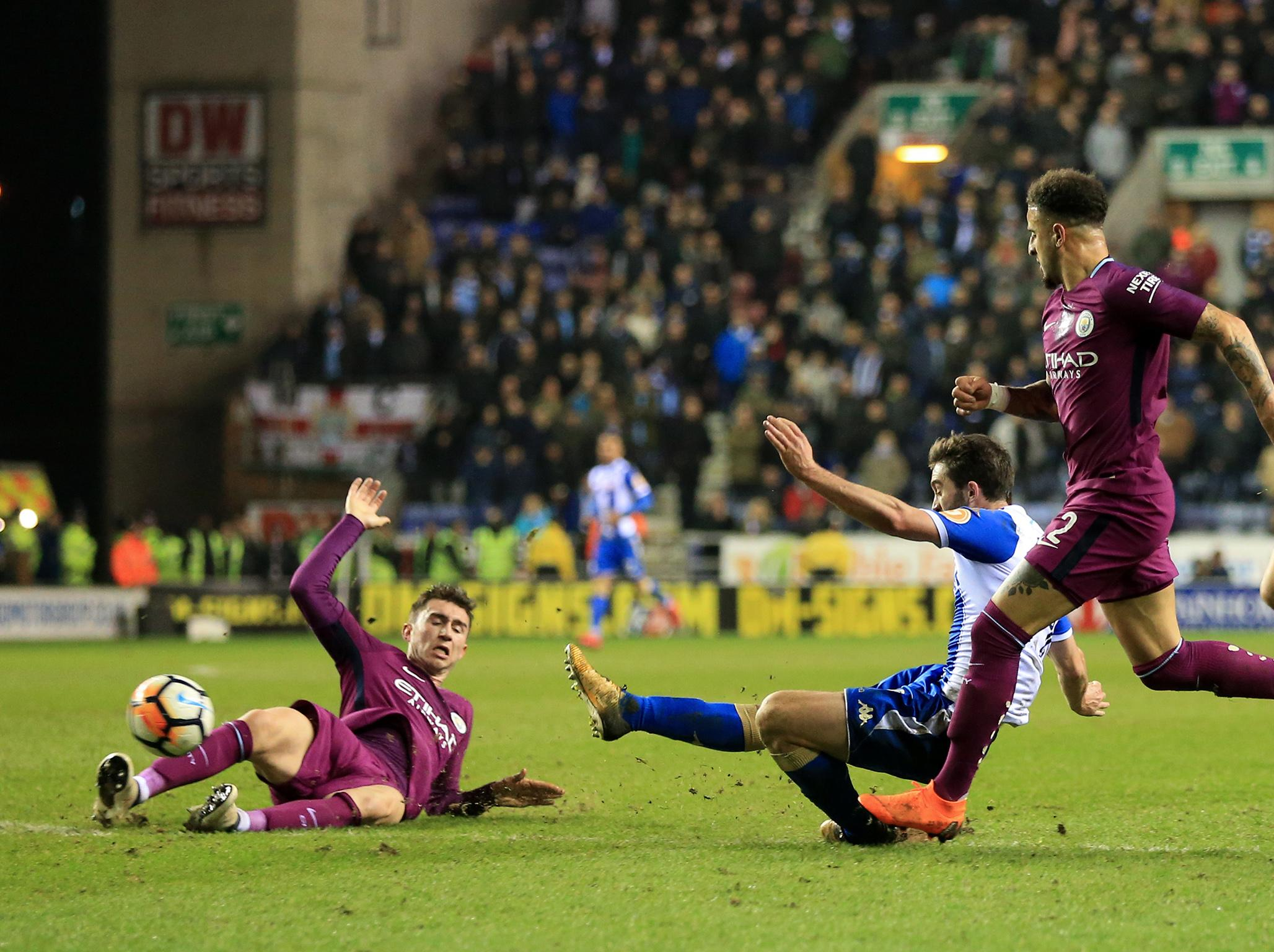 Will Grigg fires Wigan past 10-man Manchester City in feisty FA Cup tie after managers' half-time tunnel rage