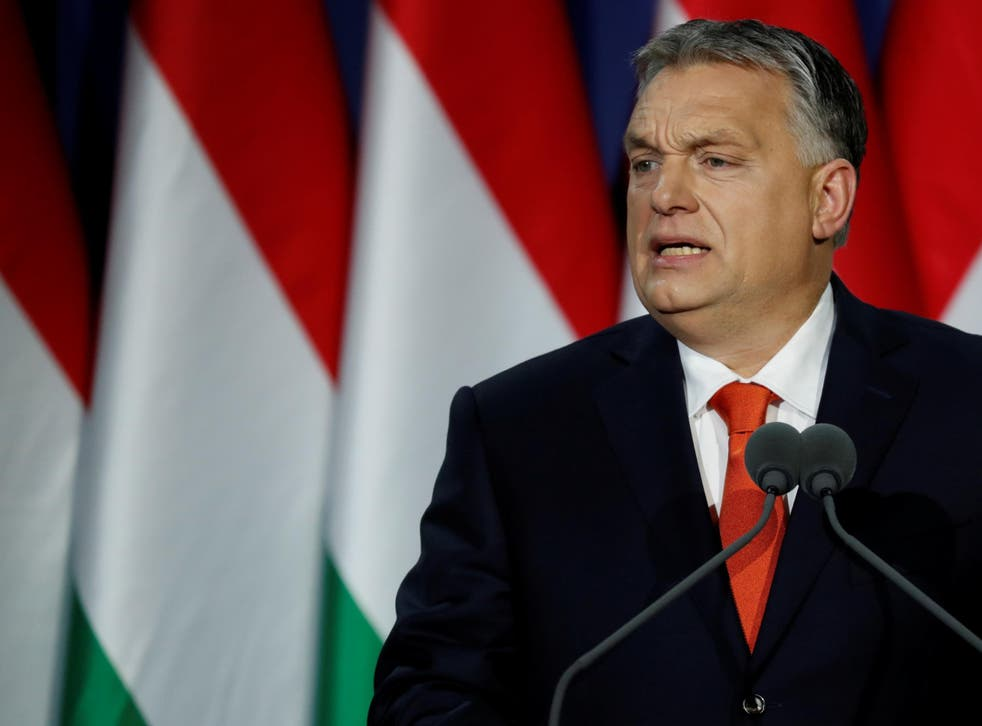 """Hungarian Prime Minister Viktor Orban delivers his annual state of the nation speech in Budapest. Slogan reads """"For us, Hungary first!"""""""