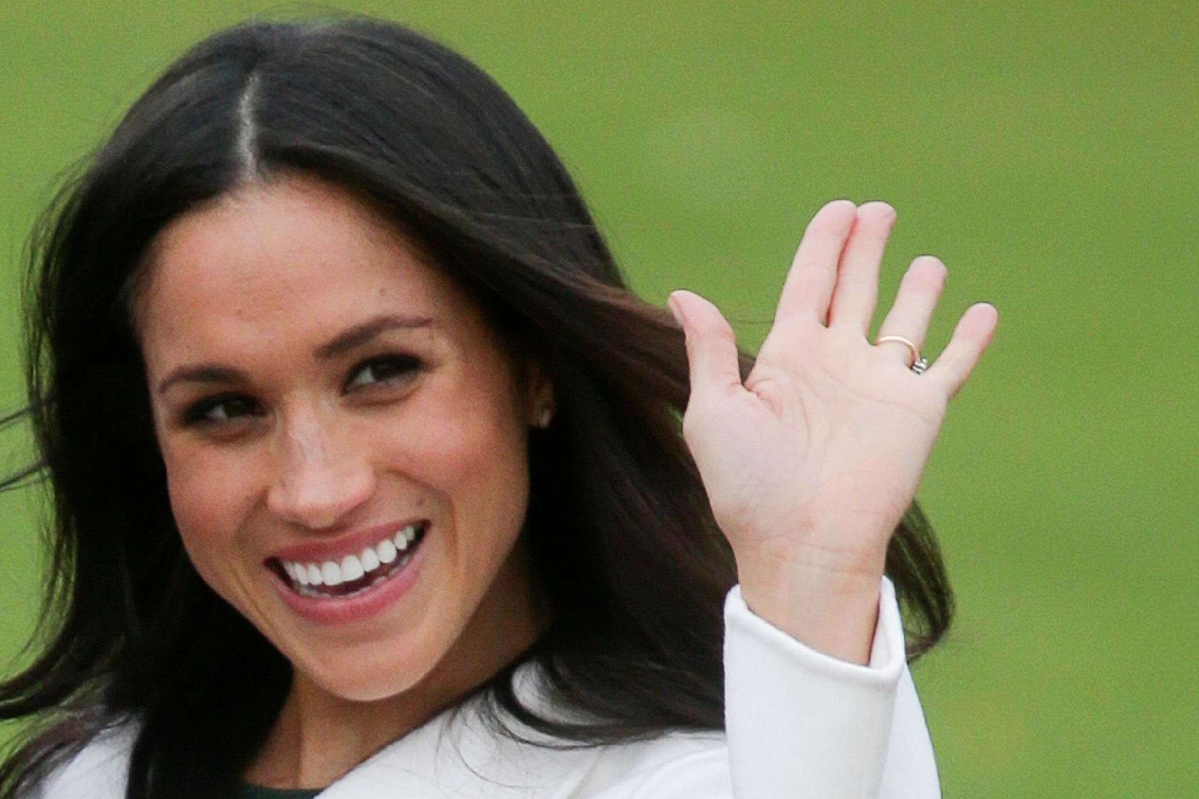 Bookies have stopped taking bets on who will design Meghan Markle's dress after a surge in bets