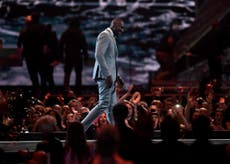 Stormzy uses Brit Awards to call out Theresa May over Grenfell