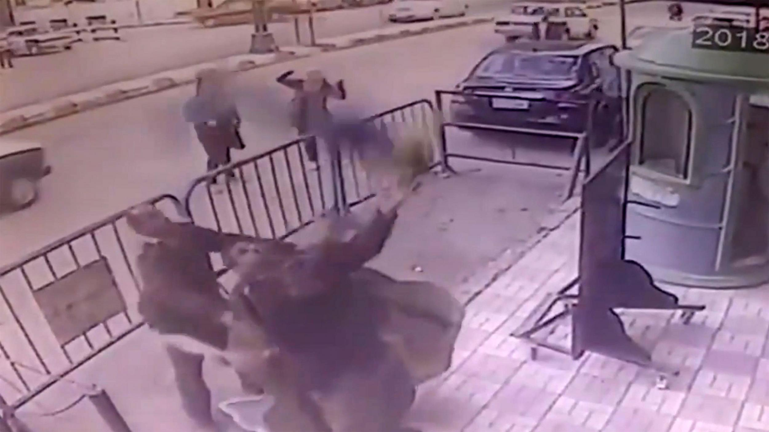 Dramatic moment Egyptian police officer saves falling child