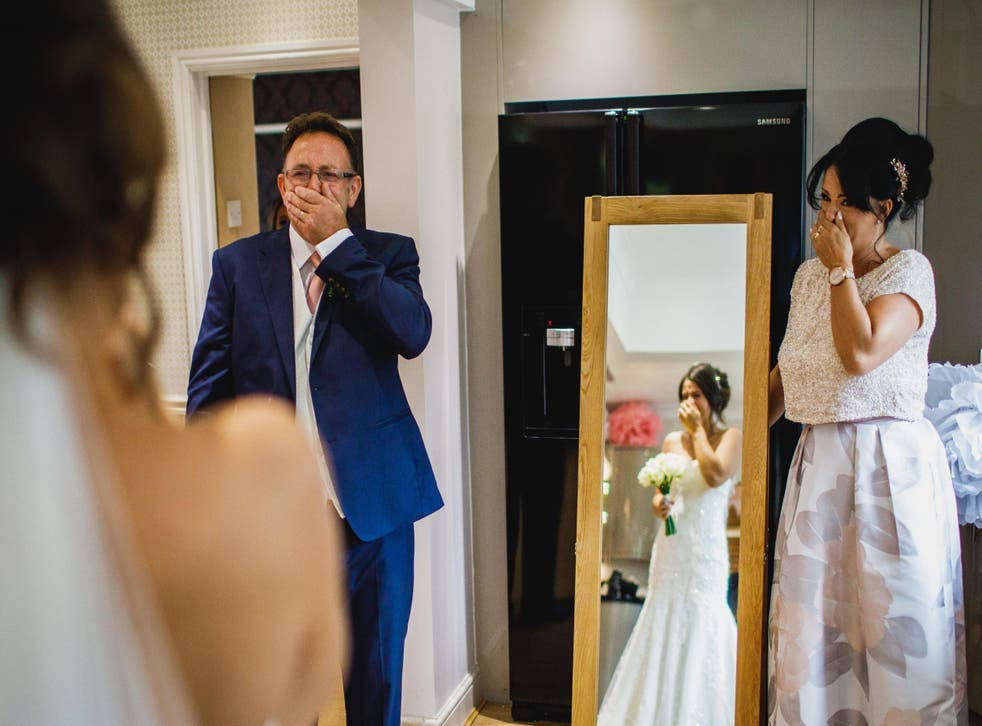 The emotional image won a Masters of Wedding Photography award for its moving message