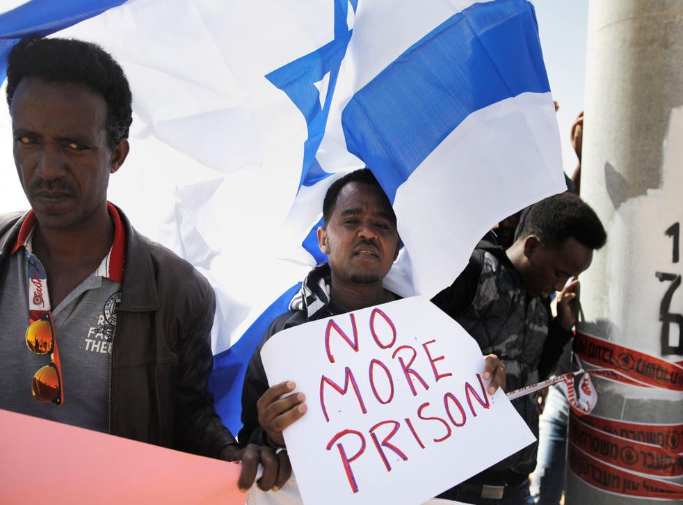 Israeli African residents protest outside Saharonim Prison, a detention facility for African asylum seekers near the border with Egypt, on 22 February 2018