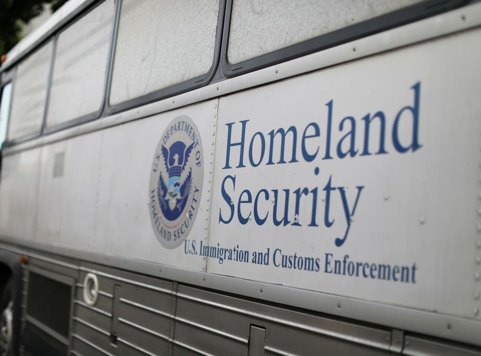 A Homeland Security Immigration and Customs Enforcement bus is seen parked outside a federal jail in San Diego, California