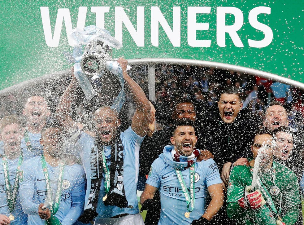 Manchester City captain Vincent Kompany lifts the EFL Cup