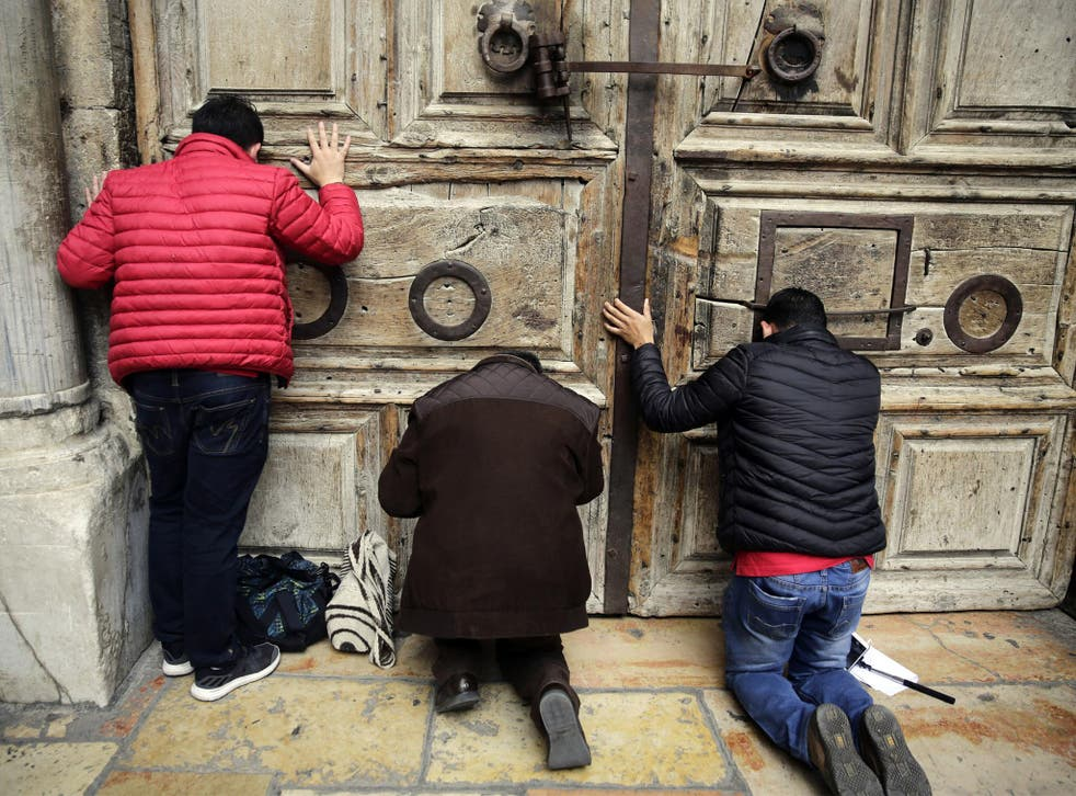 Worshippers locked out of the traditional site of Jesus' crucifixion and resurrection