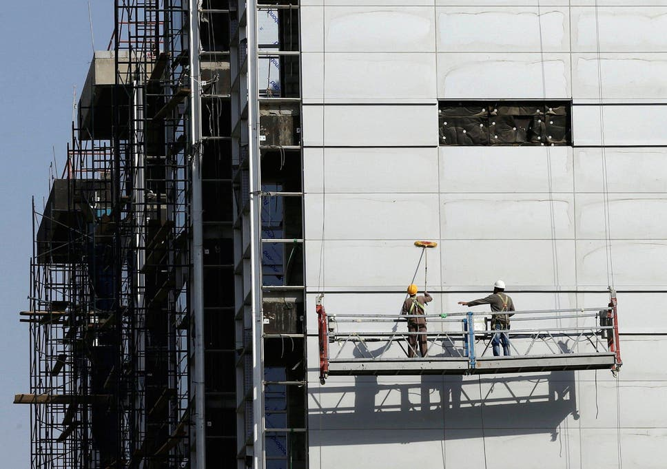 5a20dc79a1a Labourers work at the construction site of a building in Riyadh, Saudi  Arabia, October