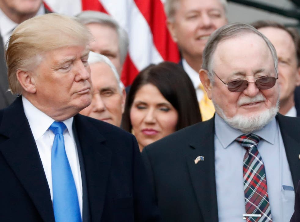 Donald Trump stands next to Alaska Congressman Don Young, who suggest Jews could have survived the holocaust if armed.