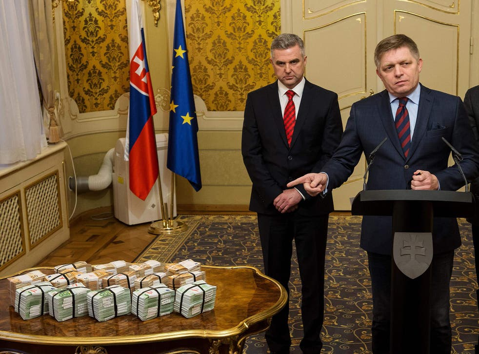 Robert Fico got the cash reward out and put it on the table. He denies any link to the mafia