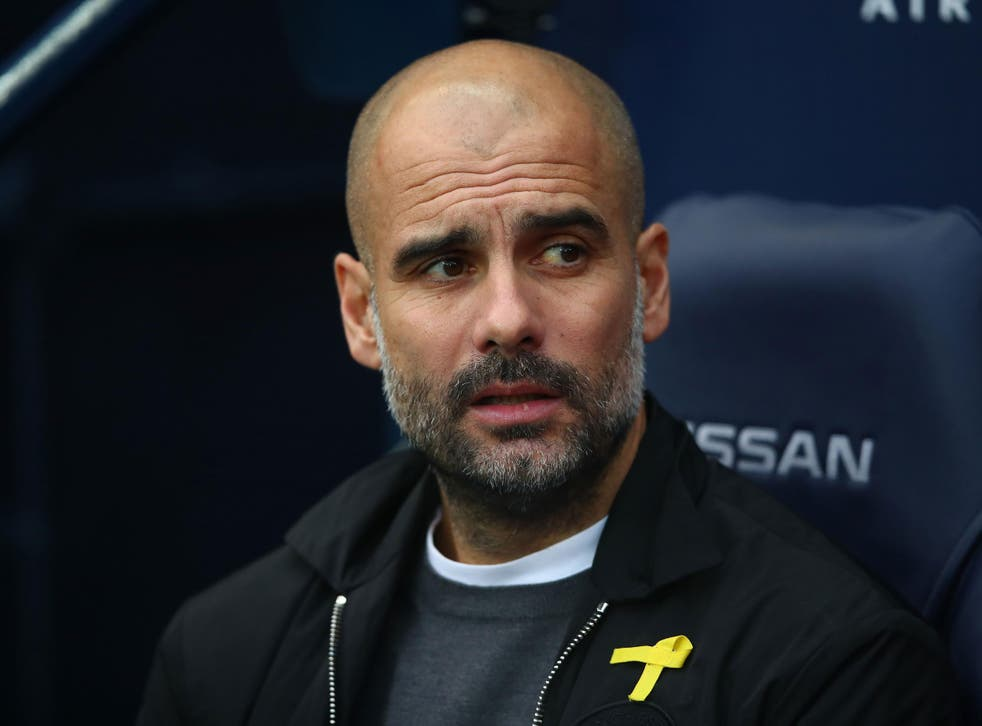 Pep Guardiola has worn the yellow ribbon during matches since October