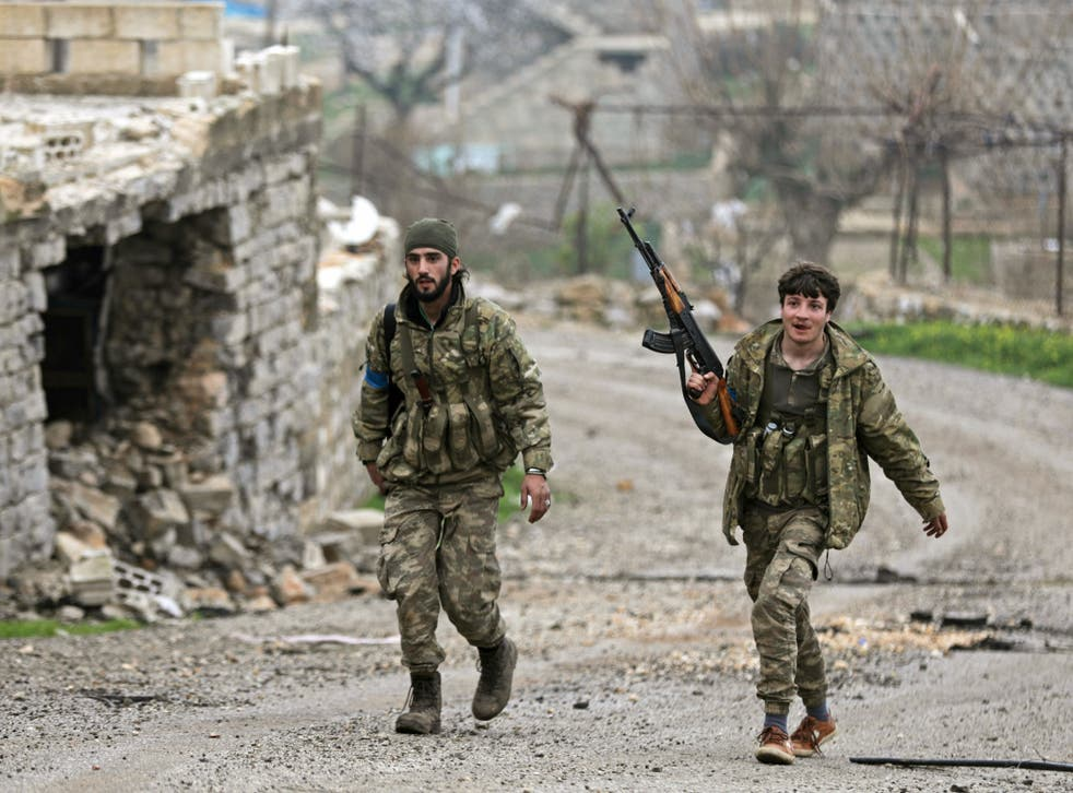 Turkish-backed fighters near the city of Afrin, Syria