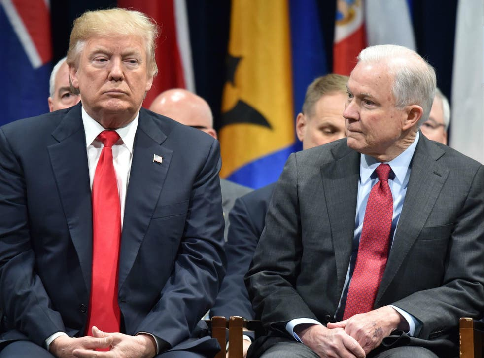US President Donald Trump sits with Attorney General Jeff Sessions on 15 December 2017 in Quantico, Virginia.