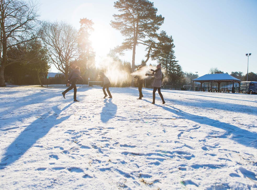 Pupils from Reigate Grammar School play in the snow