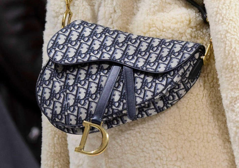 Dior s iconic logo saddle bag from early 2000s is making a comeback ... 312ecb14597c3