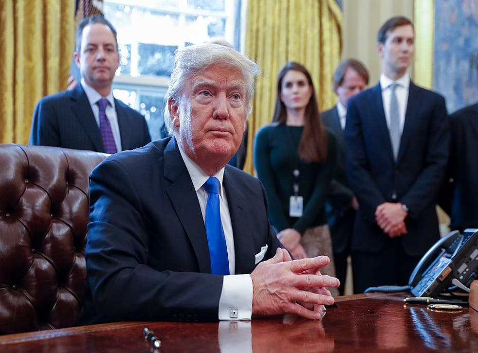 Former White House communications director Hope Hicks (second right) behind Donald Trump is the latest to leave the White House bunker