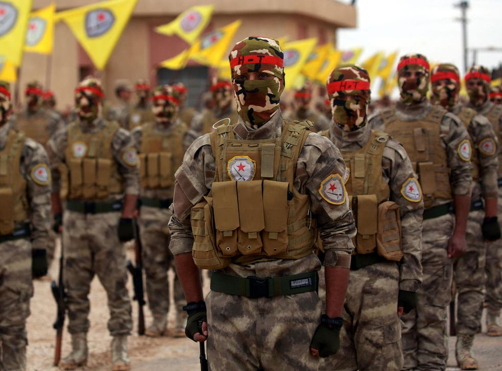 Arab and Kurdish fighters take part in a graduation ceremony in Qamishli last week. They are witnessing the Isis comeback on the front line