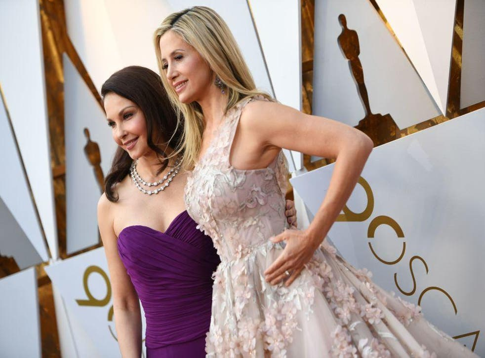 Ashley Judd (L) and Mira Sorvino arrive for the 90th Annual Academy Awards on March 4, 2018