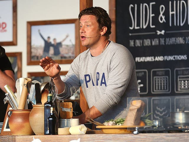 Jamie Oliver attends a cooking demonstration at the Neff Big Kitchen on day two of The Big Feastival at Alex James' Farm on August 27, 2016