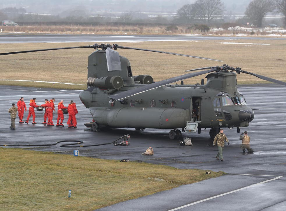 An RAF Chinook helicopter at Carlisle airport before supplies are loaded and delivered to communities still cut off after recent heavy snow in Cumbria
