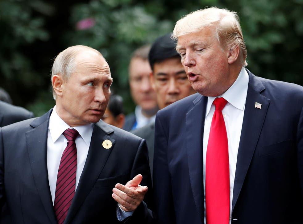 Donald Trump and Vladimir Putin talk during a photo session at the APEC Summit in Danang, Vietnam, 11 November 2017