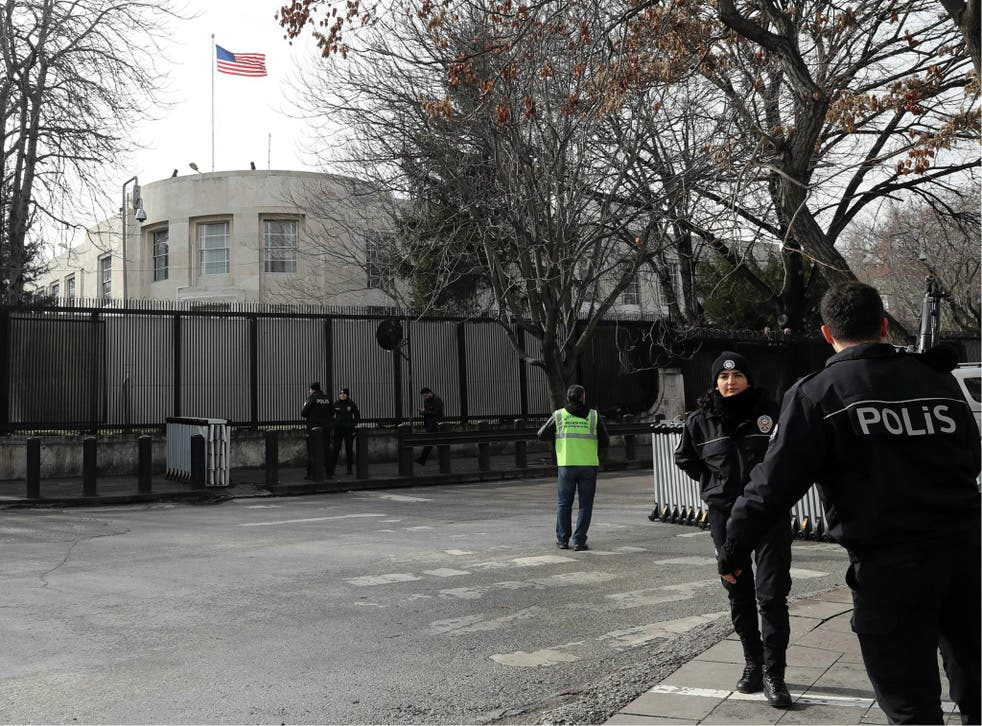 Policemen stand guard outside the US embassy in Ankara, on 5 March 2018, as part of security measures set after the embassy was closed to the public over a 'security threat'.