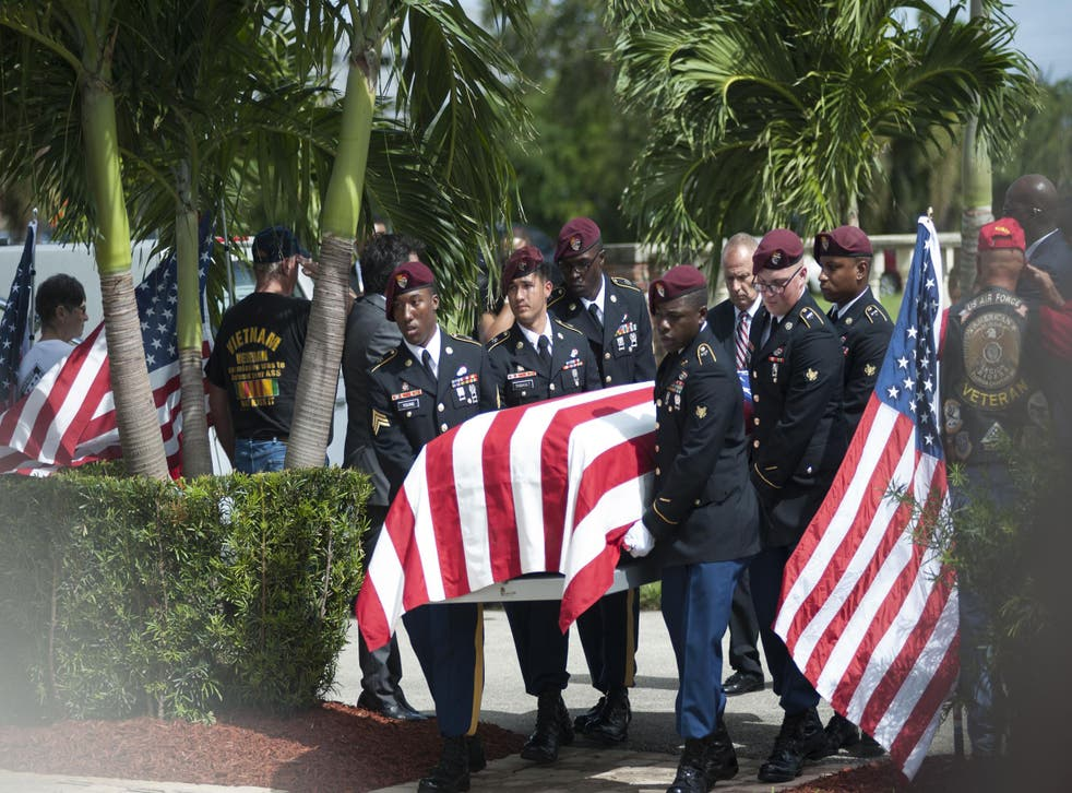 Military honour guards escorting the casket of Sgt La David Johnson, one of the soldiers killed in Niger
