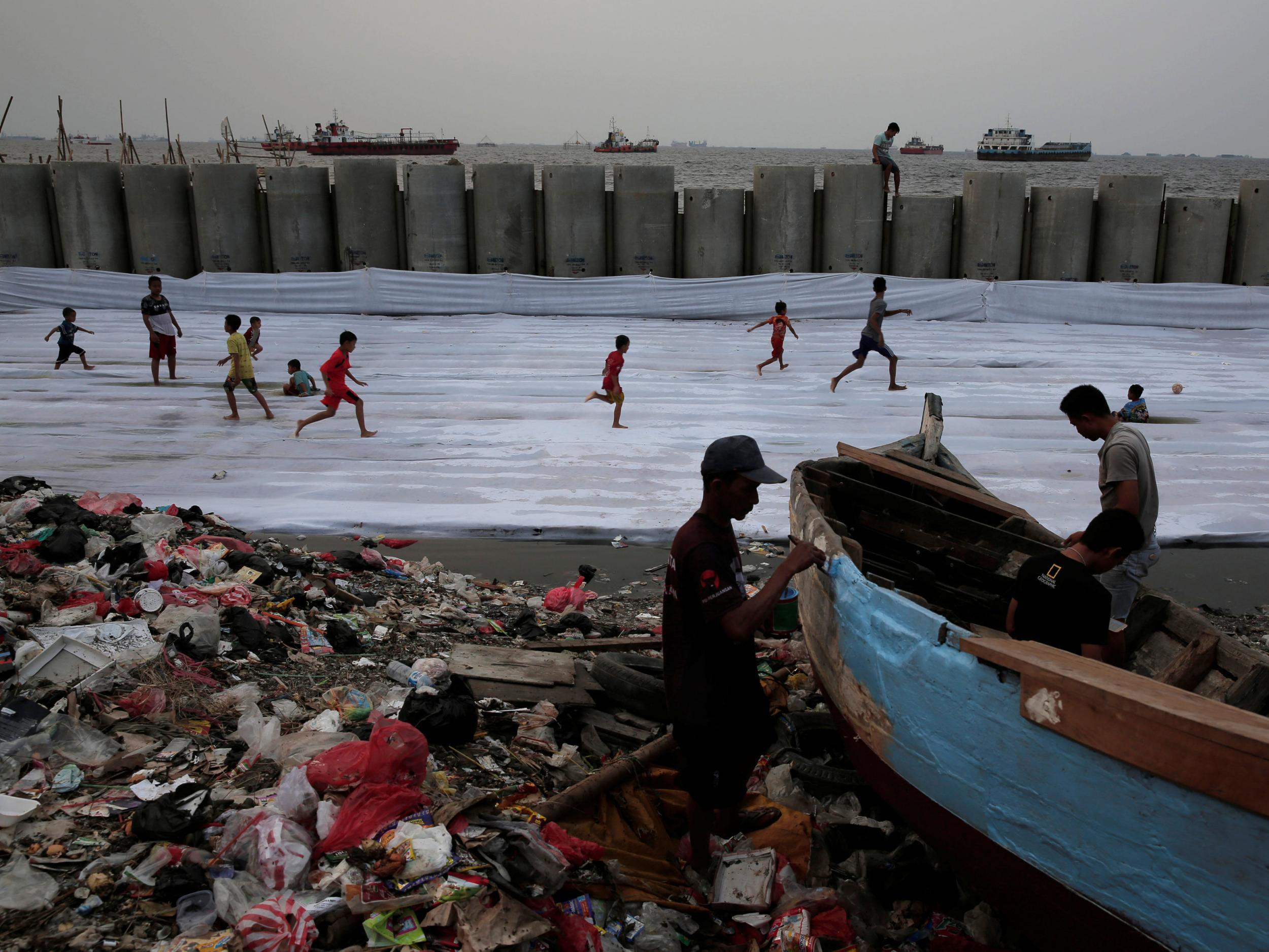 Indonesia's sinking shoreline: Climate change and environmental destruction cause daily flooding