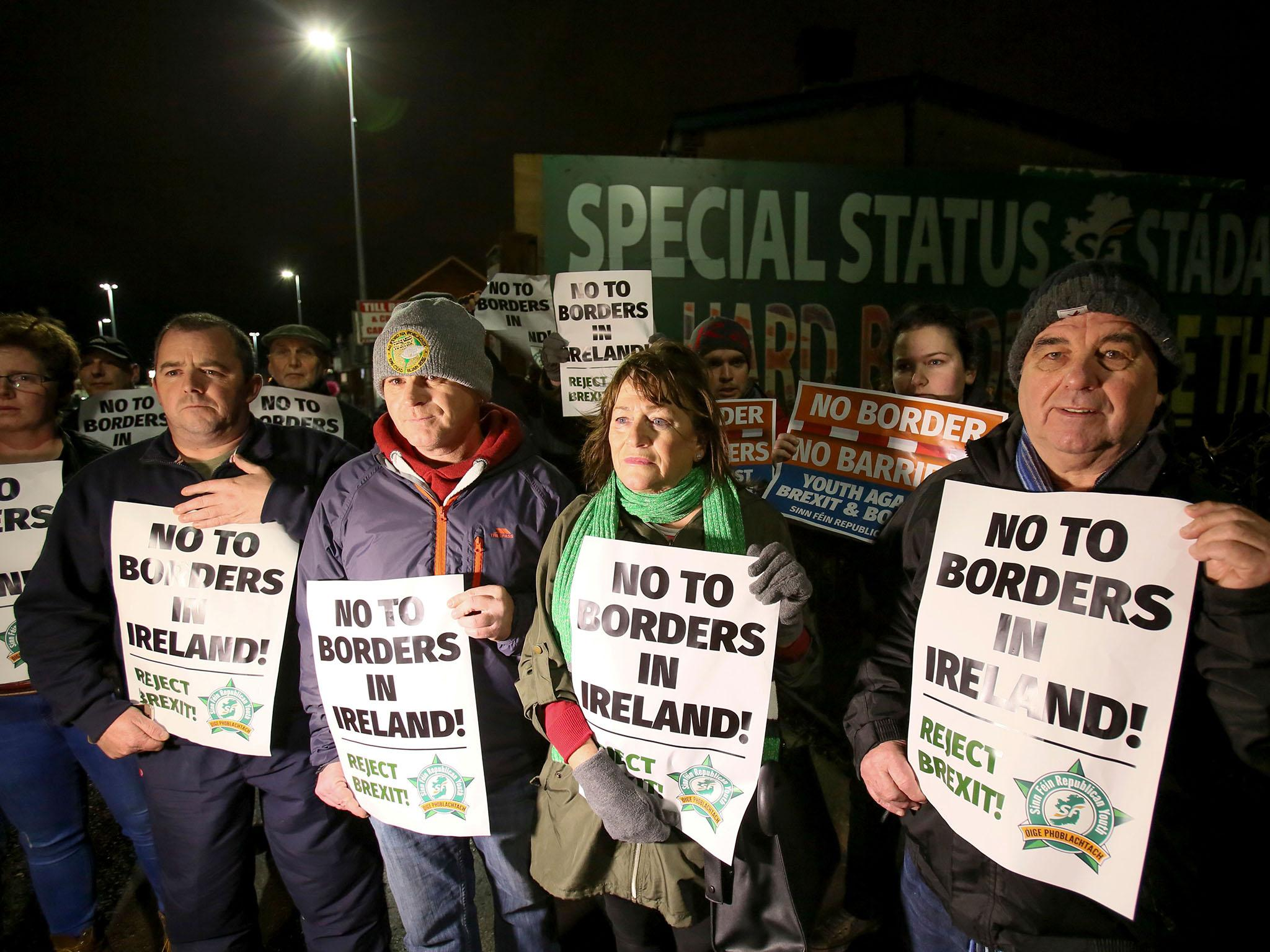 Hard border in Ireland can only be avoided if UK remains aligned with EU rules for time being, Theresa May is warned