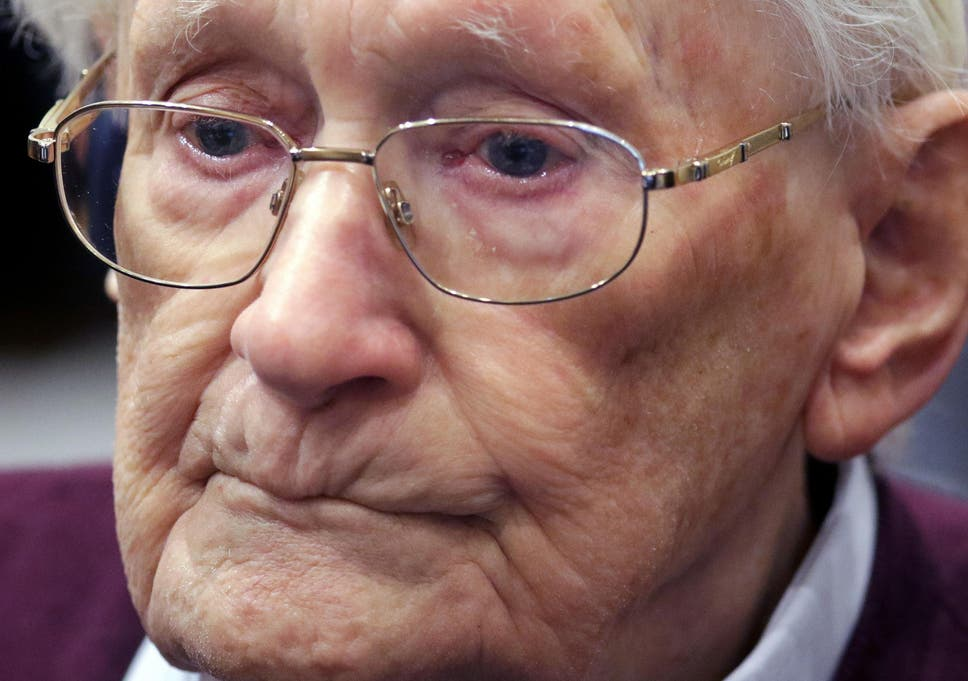 Former Ss Sergeant Oskar Groening Listens To The Verdict Of His Trial At A Court In