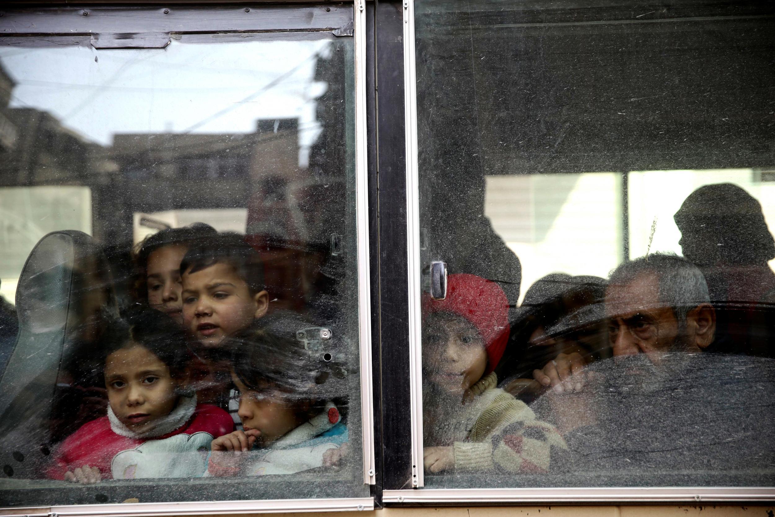 Civilian evacuations begin in besieged Eastern Ghouta as rebels vow to keep fighting