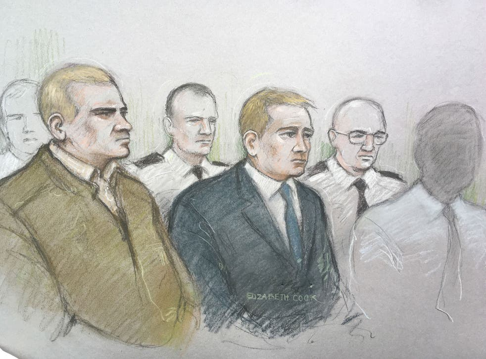Mikko Vehvilainen and Mark Barrett (centre) on trial at Birmingham Crown Court where they are  accused of being part of the proscribed organisation National Action.
