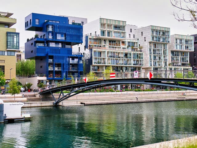 Modern apartment buildings along the Saone canal in Lyon's Confluence district