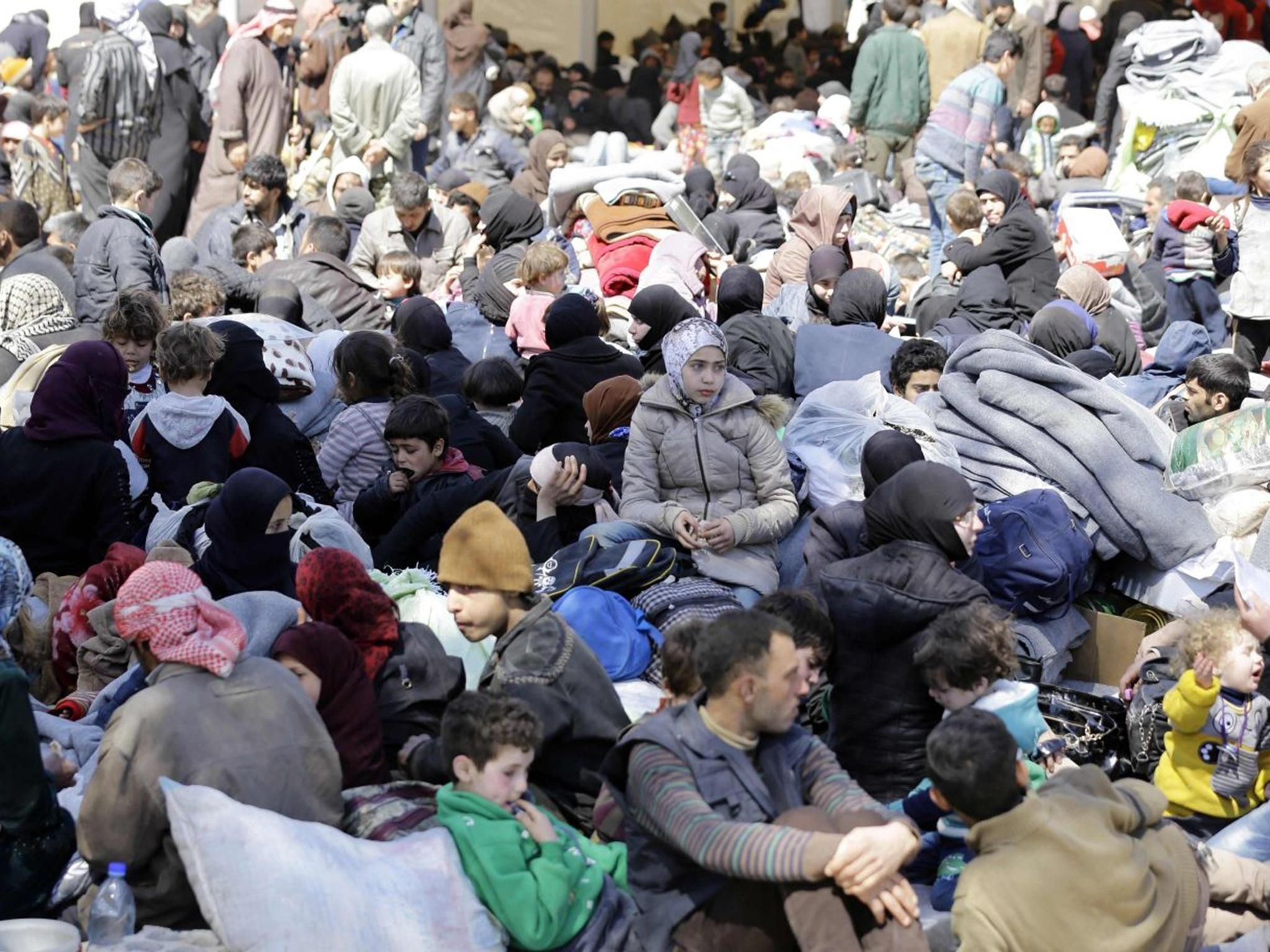More than 11,000 flee Syria's besieged Eastern Ghouta