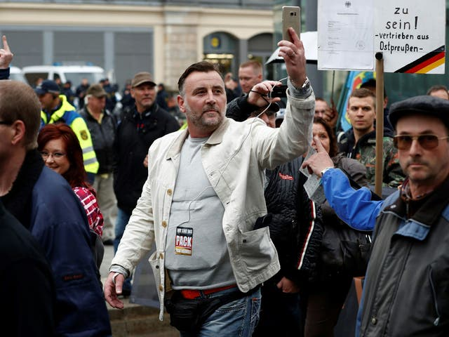 Bachmann, co-founder of the Pegida movement, takes part in a protest against German Chancellor Angela Merkel on the German Unity Day