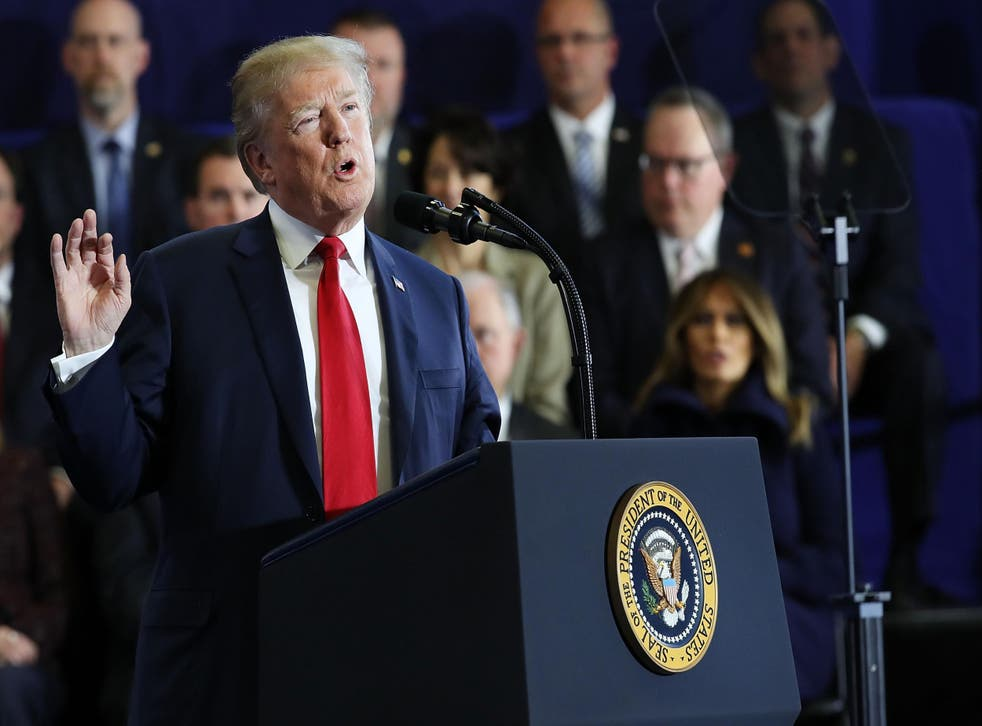 President Donald Trump speaks to supporters and local politicians at an event at Manchester Community College