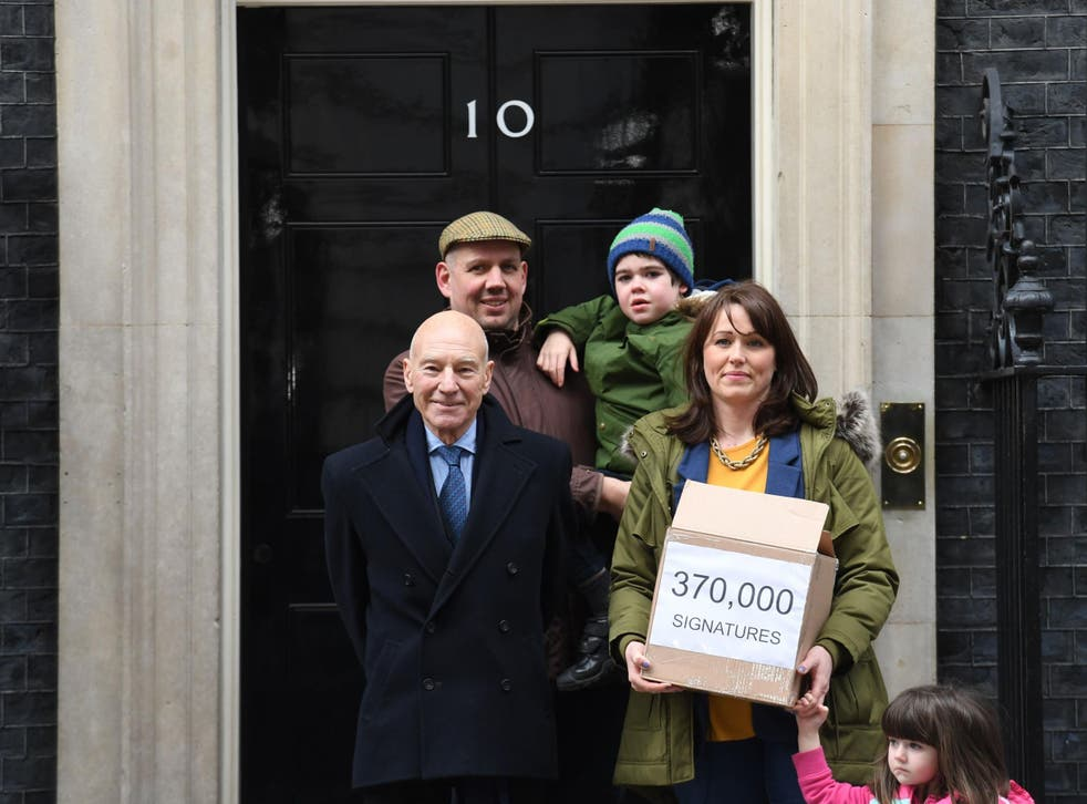 <p>Six-year-old Alfie Dingley, his parents Drew Dingley and Hannah Deacon and actor Sir Patrick Stewart (left) walk up Whitehall in London before handing in a petition to Number 10 Downing Street asking for Alfie to be given medicinal cannabis to treat his epilepsy</p>