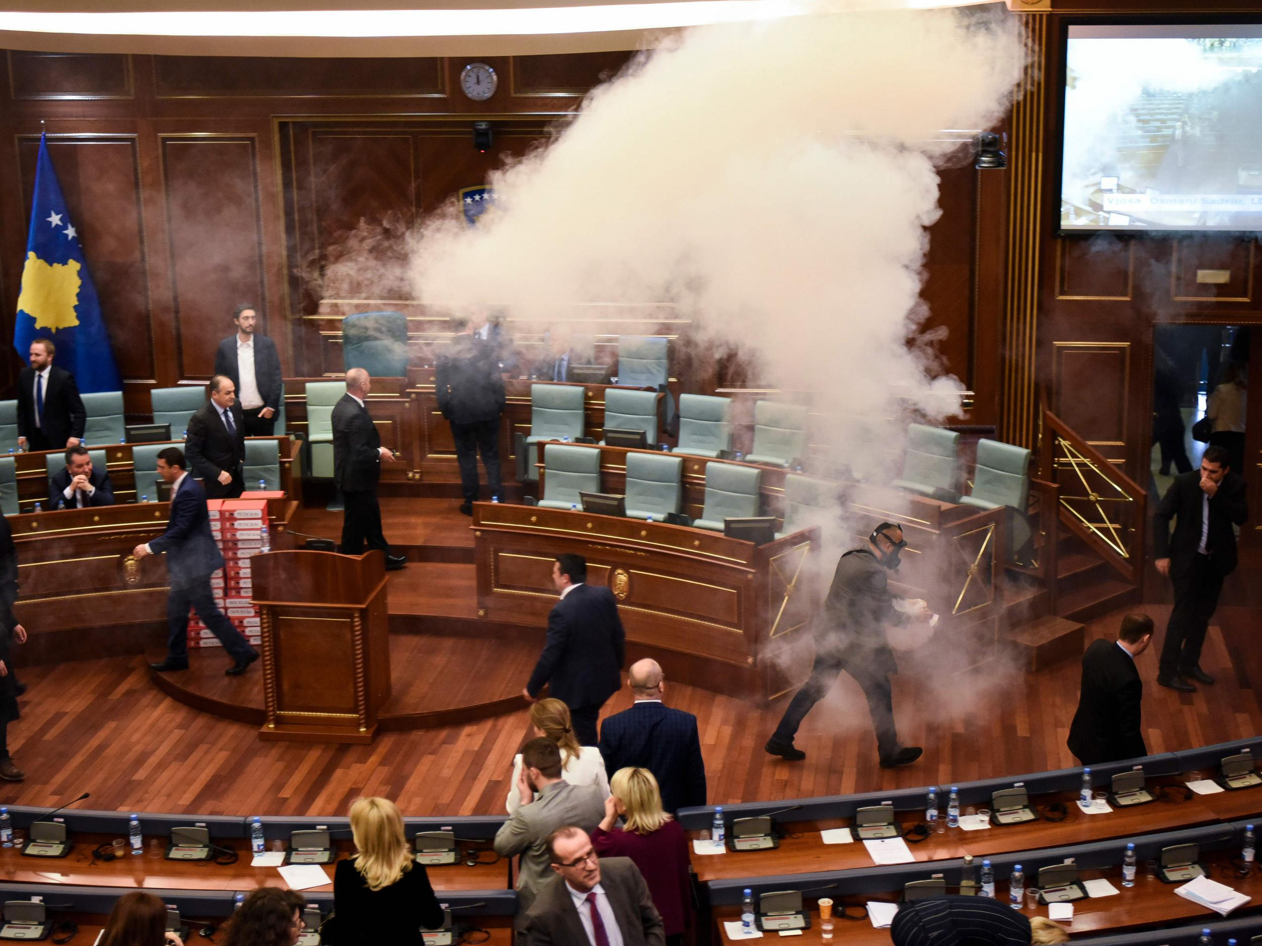 Tear gas released in Kosovo parliament by opposition party in bid to stop vote
