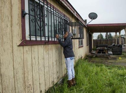 Lashunda Britt, a cousin of Stephan Clark stands near where he was fatally shot by police in Sacramento