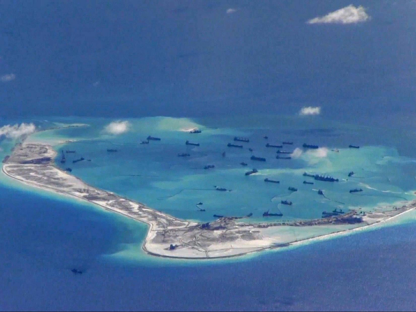 Chinese air force lands long-range bombers on island in disputed South China Sea