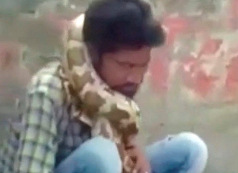 Snake charmer nearly dies after python tries to strangle him