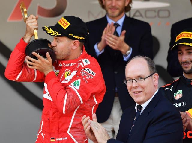 Prince Albert II (right) with Monaco Grand Prix winner Sebastian Vettel in 2017