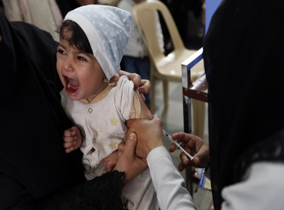 A child is given a diptheria vaccine at the health centre in the Yemeni capital Sanaa