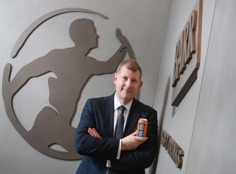 AG Barr boss Roger White with a can of Irn Bru
